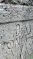 كتابات منحوتة على الحجر.png