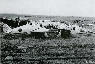 Kawasaki Ki-61 - Derelict Ki-61s in 1945 after the surrender. A Kawasaki Ki-45 heavy fighter is in the background.