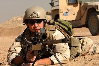Anti-materiel rifle - US Navy Explosive Ordnance Disposal technician with a McMillan Tac-50
