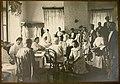 1915. 08. Медицинский персонал принимает новых раненых в приемной лазарета.jpg