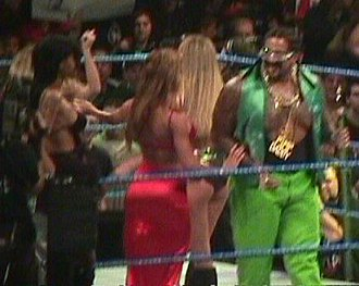 "The Godfather (wrestler) - The Godfather alongside his ""hoes"" at a SmackDown live show in 1999"