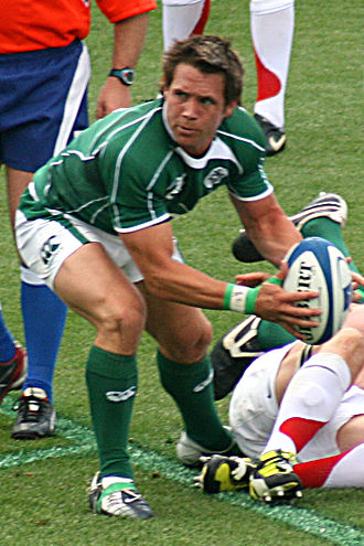 Rugby union - A player about to pass the ball