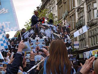 Vincent Kompany - Kompany holding the FA Cup during Manchester City's 2011 victory parade
