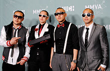 Far East Movement posing for photographers