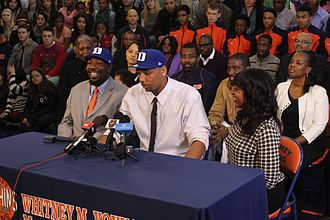 Jahlil Okafor - Okafor (center) at his November 15, 2013 verbal commitment press conference with his father Chukwudi and aunt Chinyere Okafor-Conley. Jahlil and Chukwudi are wearing Duke University baseball caps to signify his commitment.