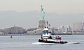 2013Dec20 Tugboat HMS Liberty passing by Statue of Liberty in New York Harbor.jpg