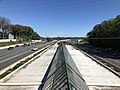 2018-10-23 12 56 21 View east along Interstate 66 and the Orange Line of the Washington Metro from the overpass for Gallows Road (Virginia State Route 650) on the border of Merrifield and Dunn Loring in Fairfax County, Virginia.jpg