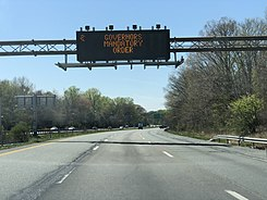 "2020-04-19 13 09 10 Variable message sign reading ""Governors mandatory order"" (referring to non-Delaware citizens having to quarantine if visiting Delaware) along southbound Interstate 95 just south of Exit 1 in Delaware County, Pennsylvania.jpg"