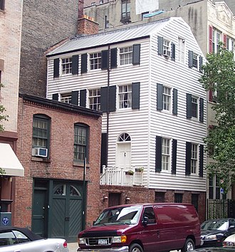 Kips Bay, Manhattan - Wood frame house and brick carriage house of uncertain age at 203 East 29th Street