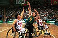 221000 - Wheelchair basketball Sandy Blythe shoots - 3b - 2000 Sydney match photo.jpg