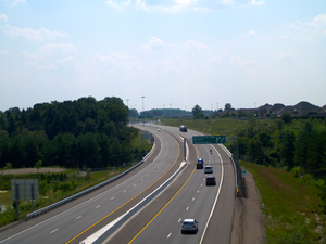 Ontario Highway 410 - The new 410 extension crossing Etobicoke Creek. Note the placeholders for high-mast lighting on the median.