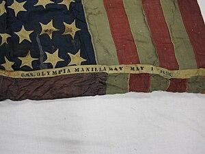 63-318-A Flag, National, US, USS OLYMPIA.jpg