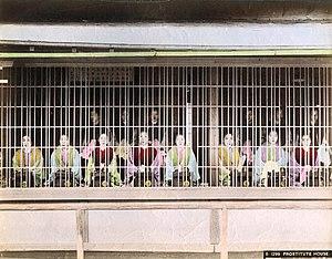 Yoshiwara - Prostitutes on display in Yoshiwara during the Meiji period