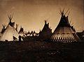 A Piegan Indian encampment, North America; tipis, including a Wellcome V0038482.jpg