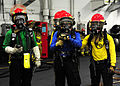 A U.S. Navy hose team waits to fight a simulated aircraft fire in hangar bay one during a general quarters drill aboard the aircraft carrier USS John C. Stennis (CVN 74) in the Pacific Ocean Aug. 13, 2011 110813-N-ED900-483.jpg