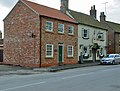 A house and a pub in Church Street Kilham.jpg