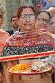 A woman welcoming groom with Pooja thali.jpg