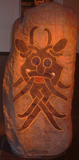 Runestone - The Mask Stone (DR 66) found in Aarhus, Denmark commemorates a battle between two kings and features a stylized depiction of a mask.