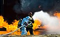 Aaron Weisenberger with the 436th Civil Engineer Squadron fire department, leads a two-person fire attack crew during fire training at Dover Air Force Base, Nov. 4, 2013.jpg
