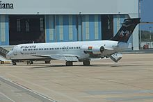 Air Burkina MD-87 (withdrawn?) parked at Olbia Airport (XT-ABD) (9501041401).jpg