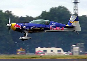 Racing - Hungarian aerobatics pilot Peter Besenyei at speed in his Extra 300 at an air race in England