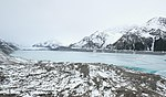 Almost completely frozen Tasman Lake with Tasman Glacier terminus in the background.jpg