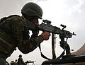 An Afghan National Army commando with the 1st Tolai, 3rd Special Operations Kandak fires an M240B machine gun during a training exercise in the Dand district, Kandahar province, Afghanistan, May 25, 2013 130525-A-QS703-069.jpg