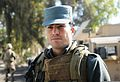 An Afghan police officer stands guard outside of the Nangarhar provincial police headquarters building during a U.S. military security force advise and assist team visit in Nangarhar province, Afghanistan 140102-A-NS540-008.jpg