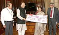 Arun Jaitley receiving a cheque of Rs. 29.85 lakh from the Managing Director and CEO of Punjab National Bank, Ms. Usha Ananthasubramanian, towards the Army Battle Casualties Welfare Fund.jpg