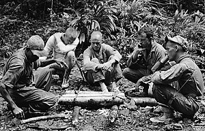 Survival skills - Astronauts participating in tropical survival training at an Air Force Base near the Panama Canal, 1963. From left to right are an unidentified trainer, Neil Armstrong, John H. Glenn, Jr., L. Gordon Cooper, and Pete Conrad. Survival training is important for astronauts, as a launch abort or misguided reentry could potentially land them in a remote wilderness area.