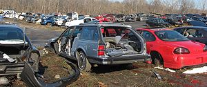 Junked cars stored at an auto scrapyard photog...