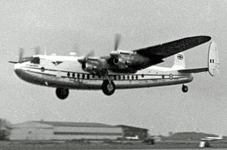 London Stansted Airport - Avro York of the based Air Charter Ltd taking off on a trooping flight in 1955 with wartime hangars in the background