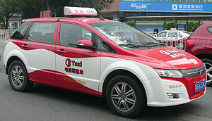 Government incentives for plug-in electric vehicles - BYD e6 all-electric taxi in Shenzhen, China.
