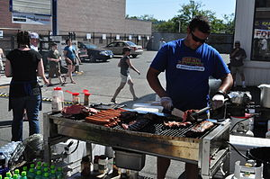 English: Grilling meat at the Ballard Seafood ...