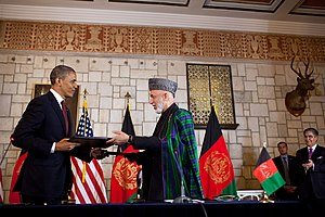 U.S.–Afghanistan Strategic Partnership Agreement - U.S. President Barack Obama and Afghan President Hamid Karzai exchange documents after signing the Enduring Strategic Partnership Agreement Between the United States of America and the Islamic Republic of Afghanistan at the Presidential Palace in Kabul on 2 May 2012.