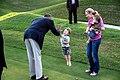 Barack Obama greets a child on the Kingsmill Resort grounds, 2012.jpg