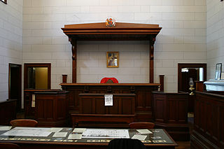 Bench (law) location in a courtroom where a judge sits