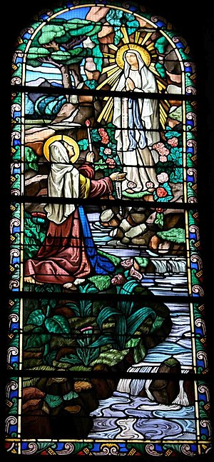Our Lady of Lourdes - Soubirous witnessing the apparition of the Virgin Mary. Stained glass, Bonneval.
