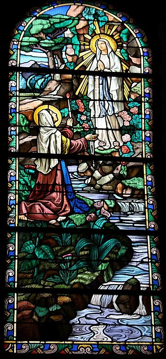 Soubirous witnessing the apparition of the Virgin Mary. Stained glass, Bonneval. Bernadette2.jpg