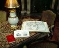 Bordet i vardagssalongen, böcker uppslagna på bordet. (Föremålsref. hänv. till mattan på bordet.) - Hallwylska museet - 39526.tif