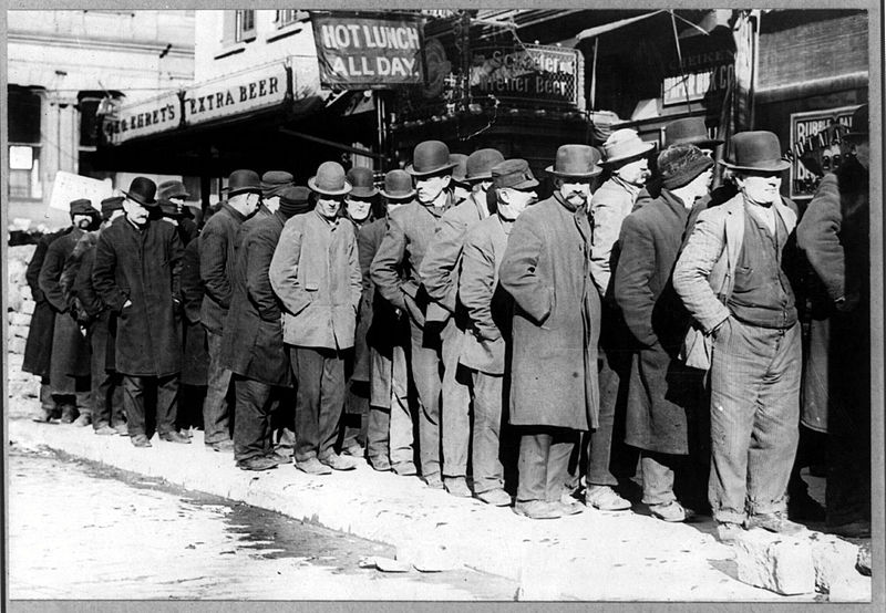 Photo of a long bread line during the Great Depression