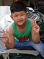Boy Flashes Peace Signs - Dien Bien Phu - Vietnam (48178536712).jpg