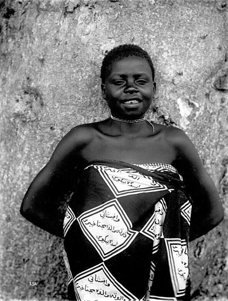 Swahili in Arabic script on the clothes of a woman in Tanzania (ca. early 1900s)