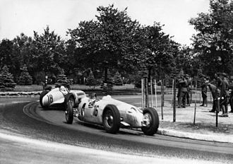 Rudolf Caracciola - Caracciola leads Auto Union driver Bernd Rosemeyer in a 1936 race. The two had an intense rivalry on track, which was only broken when Rosemeyer died trying to beat Caracciola's speed record on the Autobahn in January 1938.