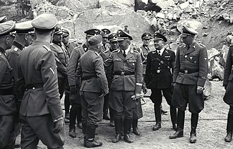 Wilhelm Bittrich - Bittrich (far right) at the Mauthausen-Gusen concentration camp during tour with Heinrich Himmler (center), June 1941.