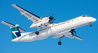WestJet Encore - WestJet Encore Bombardier Q400 NextGen with landing gear extended