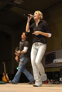 Carrie Underwood performs for US Army Troops on a USO tour in Iraq.