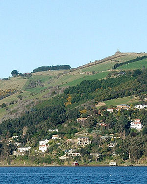 Shiel Hill - The small settlement of Challis sits at the harbour's edge below the Otago Peninsula Fallen Soldiers' Memorial, a major local landmark.