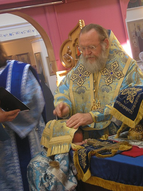 Ordination of an Orthodox priest. The deacon being ordained is kneeling with the bishop's omophorion over his head and is being blessed by the bishop straightway before the Cheirotonia. Cheirotonia Presbyter 3.jpeg
