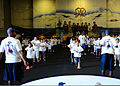 Children of U.S. Sailors assigned to the aircraft carrier USS Ronald Reagan (CVN 76) participate in the National Football League's Play 60 program in the ship's hangar bay Aug. 28, 2013, in San Diego 130828-N-SS432-040.jpg